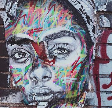 graffiti%20of%20woman's%20face%20on%20wa