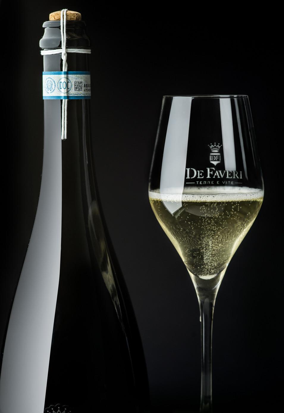 Prosecco bottiglia bicchiere foto still life studio Valdobbiadene Fotografo Vidor