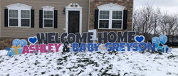 Welcome home baby yard card celebration display - mom and baby in North Huntingdon, PA