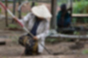 A woman deminer with UXOLao searches for unexploded ordnance in Attapeu, Laos.