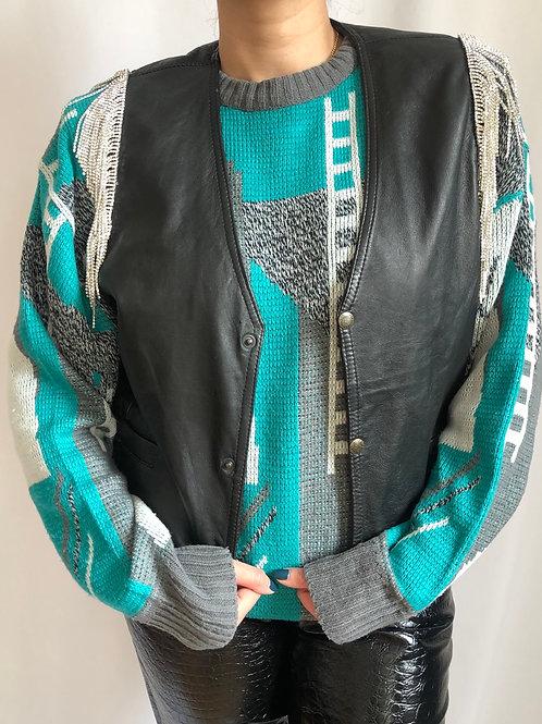 Vintage black sleeveless leather jacket with crystal fringes