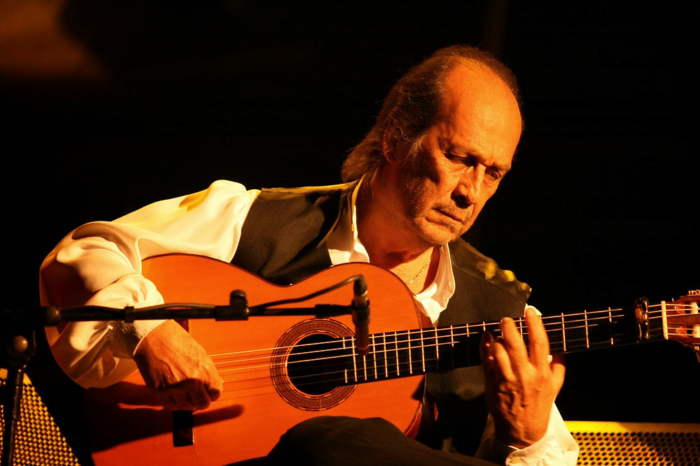Flamenco guitarist Paco de Lucia practicing traditions from flamenco's history