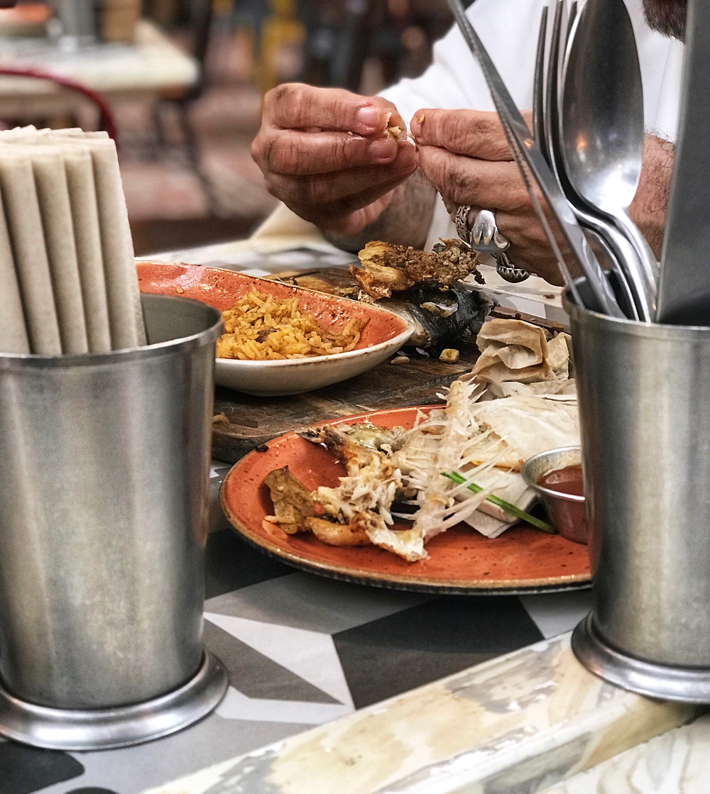 Members cook traditional meals in a shared kitchen of Gastronomic Societies