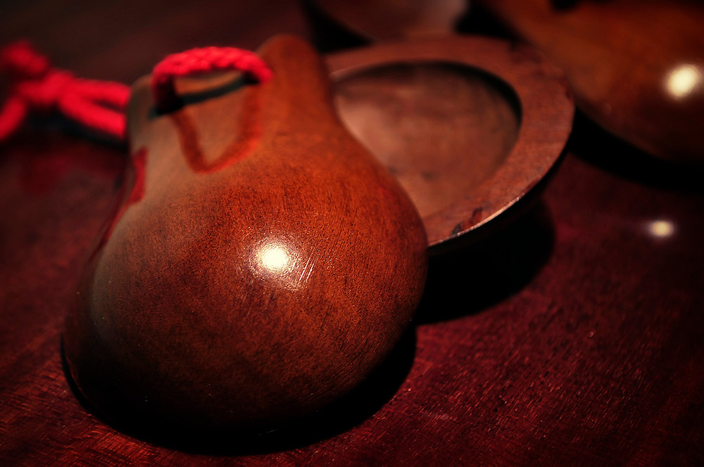 Castanets - a small, handheld percussion instrument used in flamenco throughout history