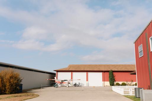 Behind the hangar