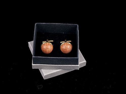 Cufflinks featurring domes of Penderyn whisky barrelwood