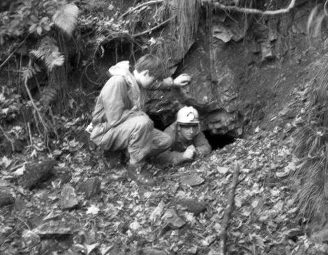 Bari Logan and Peter Warwick in small mine entrance Slinter Wood, Via Gellia, Cromford.