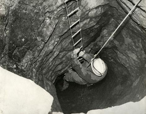 Barry Saxton in the 'through trip' mine shaft Slinter Wood, Via Gellia, Cromford.