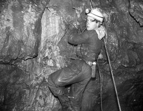 Peter Warwick on a very wet 2nd ladder pitch, Knotlow Cavern, Monyash.