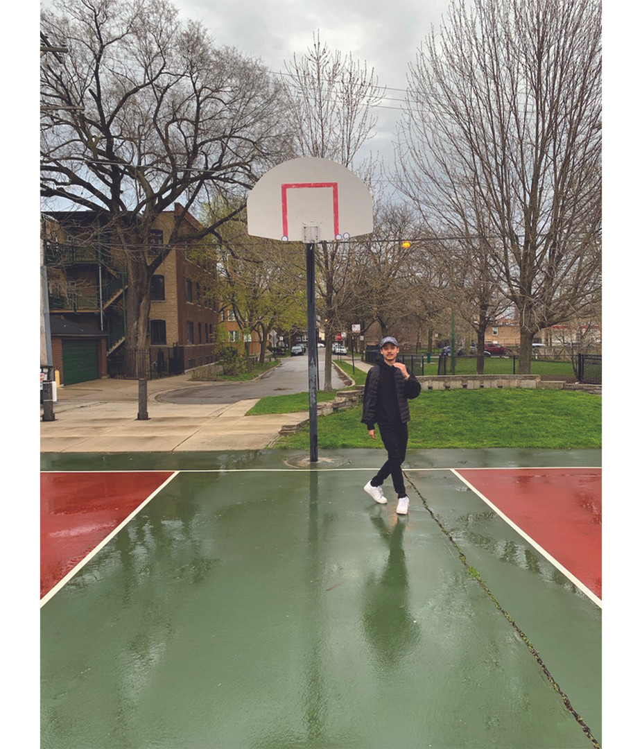 Elijah in front of removed basketball hoop