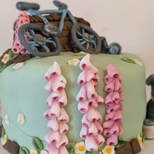 Fondant Bike Birthday Cake. Four layers of vanilla sponge filled with raspberry jam and vanilla buttercream, decorated with fondant figures