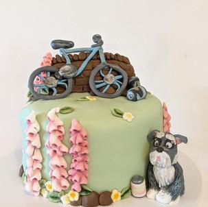 "Fondant Bike Birthday Cake. Four layers of 6"" vanilla sponge filled with raspberry jam and vanilla buttercream. Decorated with fondant figures"