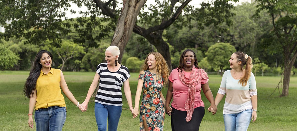 group-of-happy-women-holding-hands-and-s