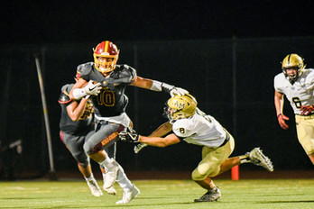 #10 breaks a tackle against Mitty