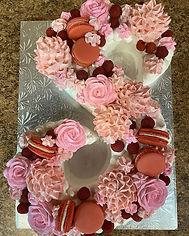S shaped birthday cake with fresh raspbe