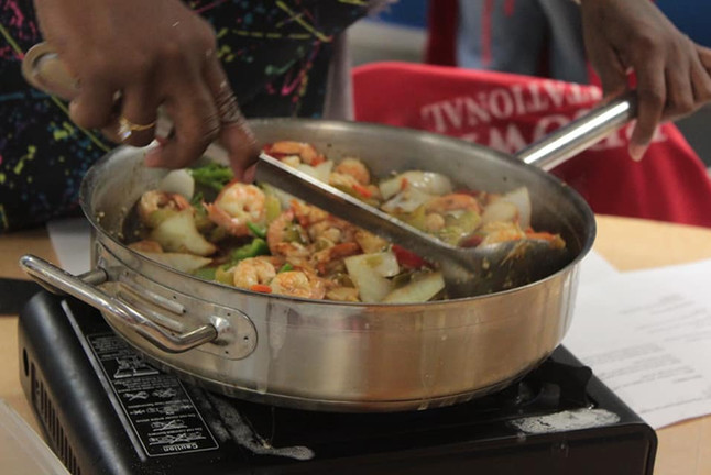 Five times a feast healthy cooking class teaches budget friendly healthy food preparation for families.
