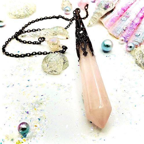 Pendule en quartz rose et cristal