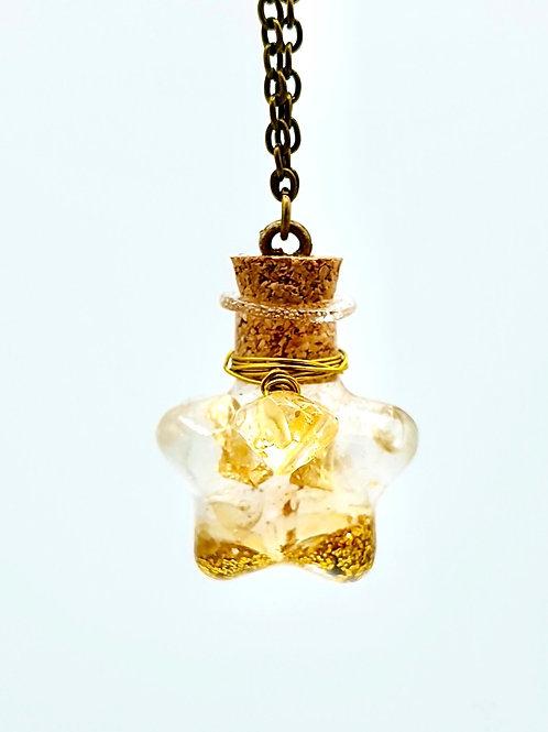 Fiole citrine, quartz à rutiles, feuille d or