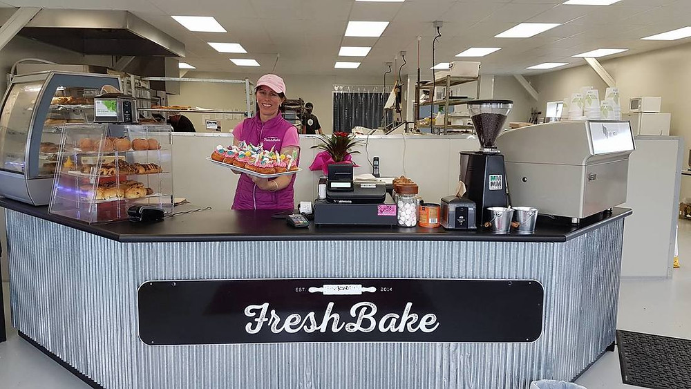 Shelley Sims from Freshbake holding some tasty baking