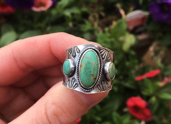Three stone cigar band ring