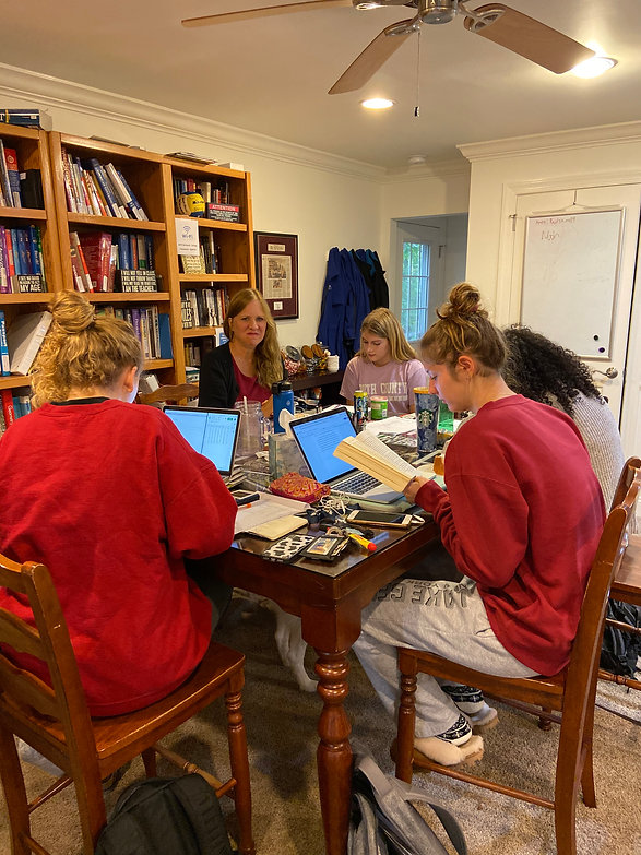 Julia Ross tutoring four students at the Professional Tutoring Cottage
