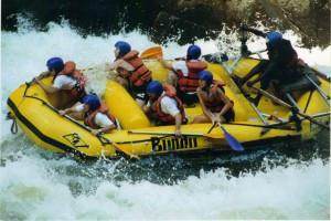 Hollie rafting the Zambezi (she is holding the blue paddle)