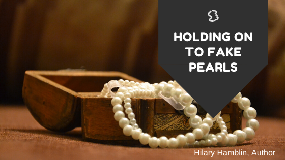 holding on to fake pearls; following God's will