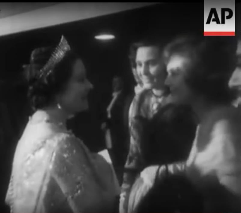 The Queen greeting Odette Churchill (left), and Anne Neagle (right).