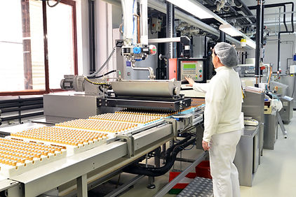 Production of pralines in a factory for