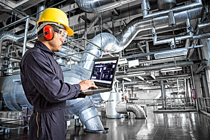 Engineer using laptop computer in therma
