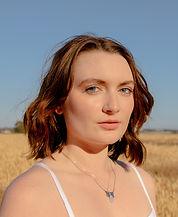 Megan Moore Head Shot_edited.jpg
