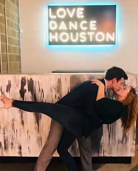 Man and woman kissing in front of Love Dance Houston Neon Sign, Wedding Prep 101, Weddng DanceGroup Class, Houston's best dance school