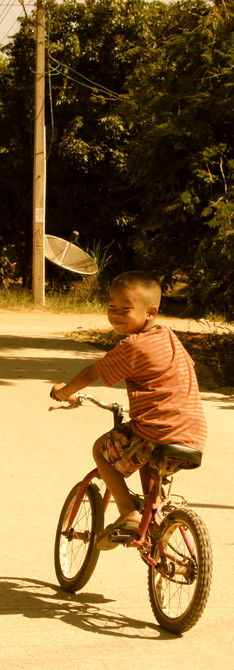 Hilltribe boy on bike