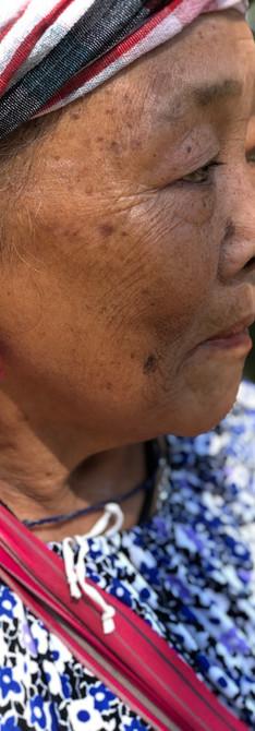 Karen Hilltribe wearing traditional tassle earrings.