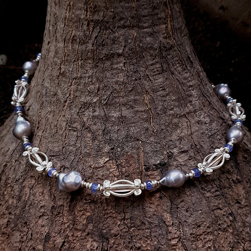 NC26: Silver crown flower, grey baroque pearl and blue sapphire necklace.