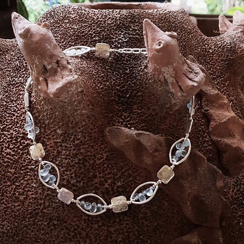 NC27:  Silver,  Oval frame beads,   Aquamarine teardrops necklace.