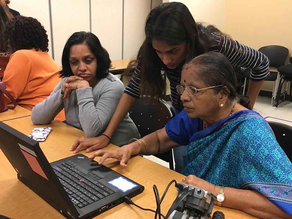 Smrithi Mahadevan teaching how to program the robot