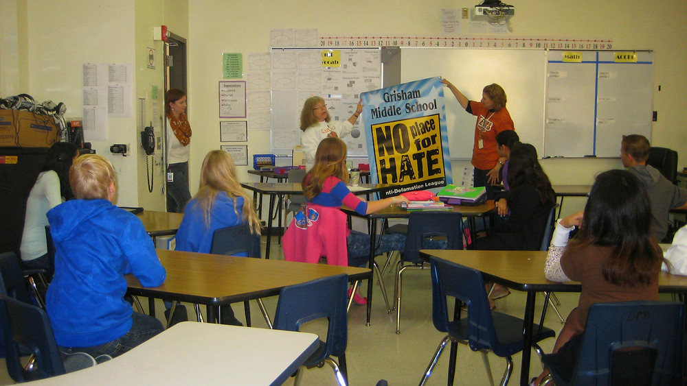 Ms. Kahn and Ms. Medina holding up No Place for Hate Poster