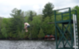 Mike Giunta's son Macallan has a cold dip at Camp Ponacka in Bancroft Ontario