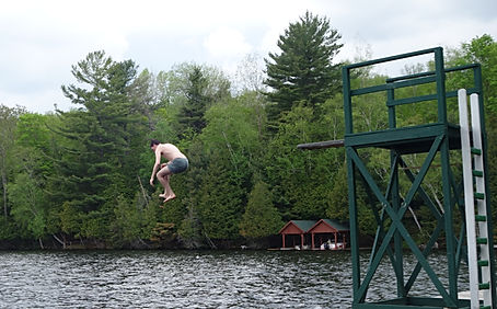 Michael Anthony's son Macallan has a cold dip at Camp Ponacka in Bancroft Ontario