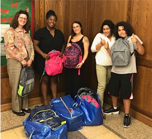New Britain teens held a youth party in August 2019 to support the collection of donations for 30 back-to-school backpacks for students at Northend Elementary School in August 2019.  Youth party was sponsored by NHSNB with help of YWCA New Britain.  Second from left, Principal Talisha Foy displays packed backpacks with her staff at Northend
