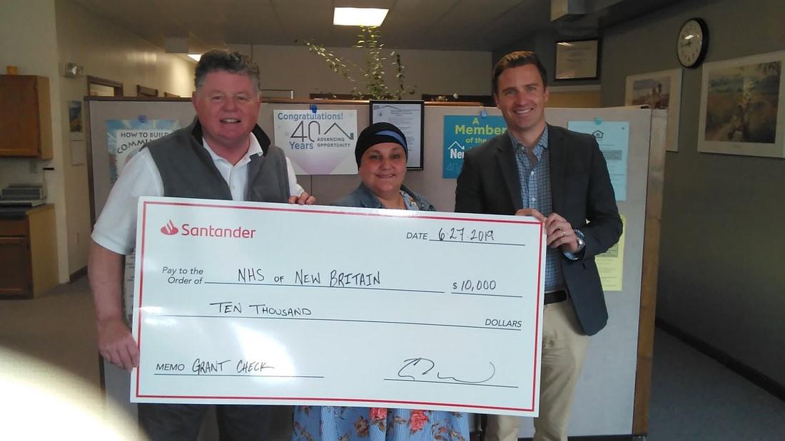 Santander Bank awards NHSNB, Inc. with a grant of $10,000.    From left, John Kukulka, Executive Director of NHSNB; Idalis (Dolly) Moreno, Supervisor, Homeowner & Foreclosure Program; and Graham Chapman, Manager, Community Partnerships for Santander Bank.