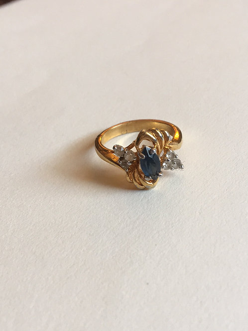 Gold toned ring with blue rhinestone