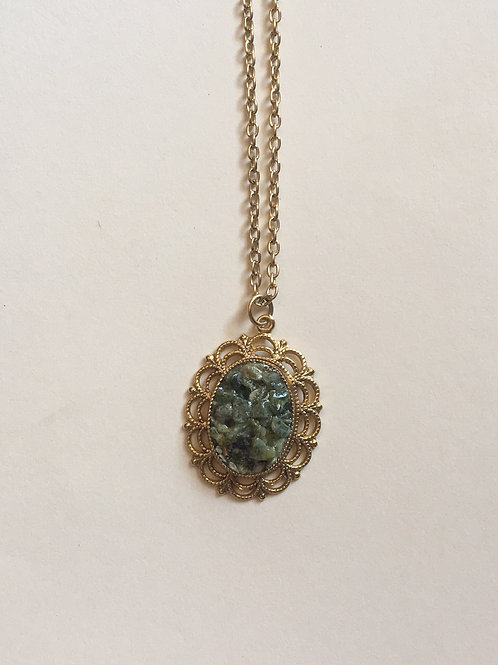 Gold toned green necklace