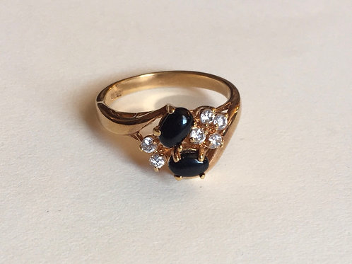 Gold toned ring with black stones