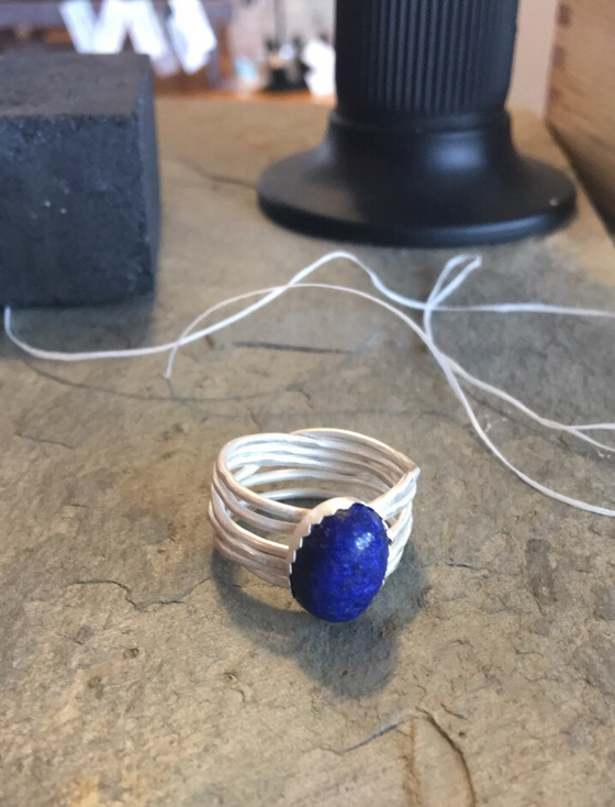 Starting to set this stone!   Yesterday this ring was just wire and some bits of sheet silver.  Now