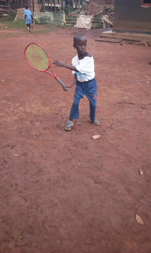 Underprivileged child in Uganda plays tennis