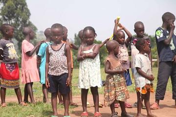 Poor children in Uganda impacted by Second Serve play tennis