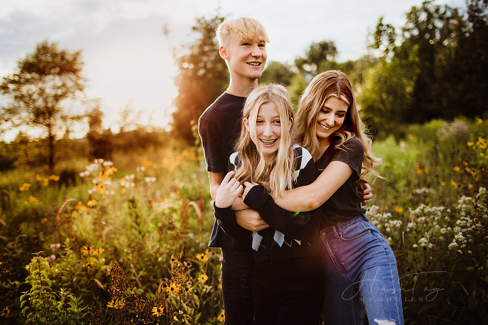 indiana teen siblings in wildflower field with Hashtag Memories Photography