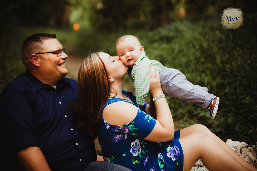 Mom in blue dress with infant for family photos by HashTag Memories